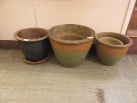A selection of glazed garden pots