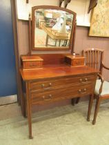 An Edwardian mahogany and strung dressing chest