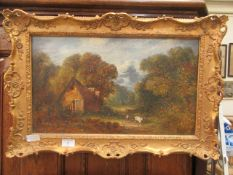 An ornate gilt framed oil on canvas of cottage scene