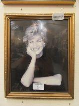 A framed and glazed photographic print of princess Diana
