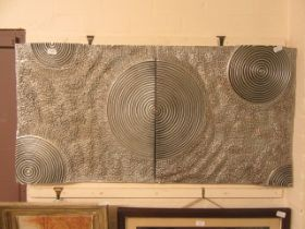 Two modern wall artworks with circular design