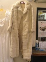 A white simulated fur coat