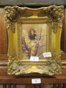 An ornate framed and glazed print of a fairy