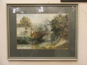 A framed and glazed watercolour of bridge next to pub scene signed Wright 1982