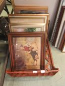 A tray containing a selection of framed artworks to include prints, photographs,