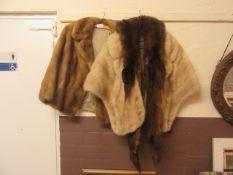 A fur jacket, shawl,