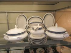 A part Royal Doulton dinner set 'Sherbrooke' comprising of meat plates, tureens, bowls,