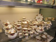 A large collection of Royal Albert 'Old Country Rose' to include cups, saucers, plates, clock,