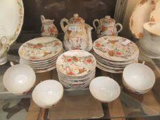 An oriental part tea set comprising of cream jug, sugar bowl, tea pot, plates, cups,