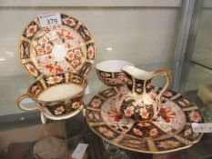 A collection of Royal Crown Derby ware to include cup, saucer, plate, sugar bowl,