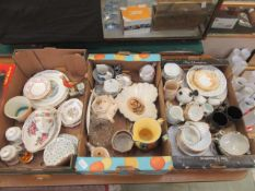 Three trays of decorative ceramic ware to include plates, pouring jugs, mugs, cups, saucers,