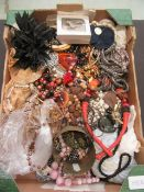 A tray of assorted costume jewellery to include beads, bangles,