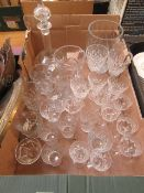 A tray containing an assortment of drinking vessels, glass decanter,