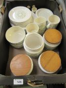 A tray containing a part Hornsea table set to include cups, saucers, storage jars etc.