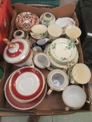 A tray of assorted decorative ceramic tableware to include cups, saucers,