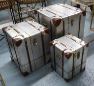 AVIATOR TRUNKS, a set of three vintage style metal with studded detail, largest 51cm W x 51cm D x