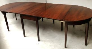 DINING TABLE, George III period figured mahogany with twin rounded ends and twin flap centre,