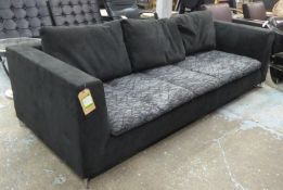 LIGNE ROSET SOFA, black with patterned cushions on metal supports, 95cm x 230cm.