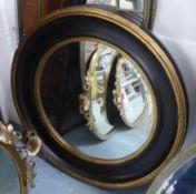 WALL MIRROR, Regency style, ebonised frame, 80cm diam. (with faults)
