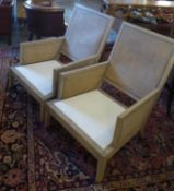 ARMCHAIRS, a pair, each with a caned front, back, both sides and a cream seat, 70cm W x 89cm H. (