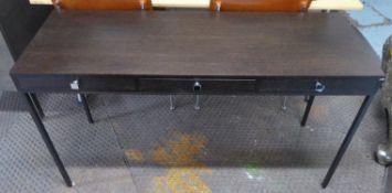 WRITING DESK, contemporary, three drawers, 129cm x 47cm x 74cm. (slight faults)