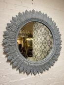 STARBURST WALL MIRROR, 1960's design, carved and painted wood, 92cm diam.