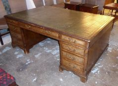 PARTNER'S DESK, George III style walnut with a green leather and gilt tooled top above nine