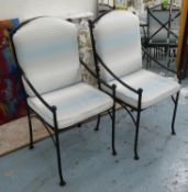 DINING CHAIRS, a matched set of six, painted black metal with loose seat cushions, 105cm at tallest.