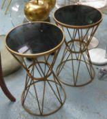 SIDE TABLES, a pair, trapeze design, gilt metal, smoked glass tops, 65cm H x 40cm diam. (2)