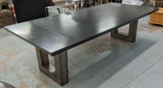DINING TABLE, contemporary ebonised top, on steel pedestals, 275cm x 130cm x 78cm. (with faults)