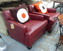 HOWARD CHAIRS LTD ARMCHAIRS, a pair, red leather, each with a Jonathan Adler cushion, 85cm W. (2)