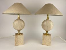 ATTRIBUTED TO PHILIPPE BARBIER TABLE LAMPS, a pair, 1970's French travertine and brass, with shades,