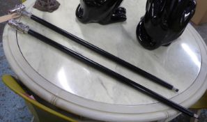 WALKING CANES, a pair, ebonised with concealed telescopes in the handles, 98cm L approx. (2)
