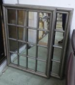 WALL MIRRORS, a pair, vintage style with silvered frames with black fleck detail, 106cm x 75cm. (2)