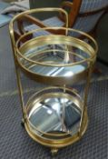 DRINKS TROLLEY, 1960's French style, gilt metal, with two mirrored tiers, 76.5cm H.