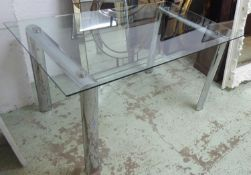 DINING TABLE, with a rectangular glass top on twin chrome supports, 150cm L x 76cm H x 90cm D.