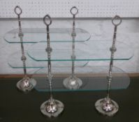 CAKE STANDS, a pair, 1920's French style, glass and polished metal, 45.5cm x 20.5cm x 48cm. (2)