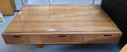 LOW TABLE, contemporary design, with various drawers and a glass top, 127cm x 76cm x 36.5cm.
