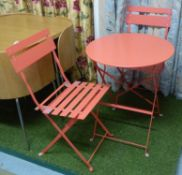 GARDEN DINING SET, including table and two chairs, red metal chairs 85cm H, table 60cm diam x