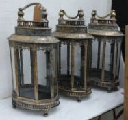 STORM LANTERNS, a set of three, antiqued gilt finish, 158cm H. (3)