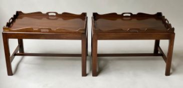 TRAY TABLES, a pair, George III design, mahogany, each rectangular handle pierced, on stands,