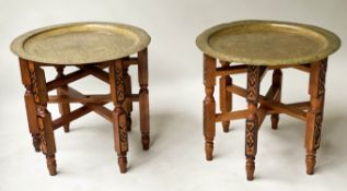 OCCASIONAL TABLES, a pair, early 20th century with Benares type brass incised tray tops and carved