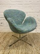 AFTER ARNE JACOBSEN SWAN CHAIR, polished aluminum swivel base, upholstered in designers guild