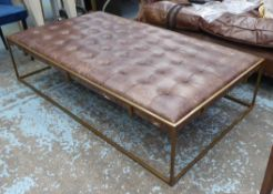 OKA WALLACE COFFEE TABLE/OTTOMAN, brass coloured framed with a padded, deep buttoned top upholstered