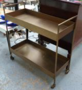 DRINKS TROLLEY, in a bronzed metal finish, on castors, 36cm D x 85cm H x 84cm W.