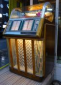 WURLITZER MODEL 1650 JUKE BOX, circa 1954, with records, 83cm x 70cm x 140cm. (sold as seen)