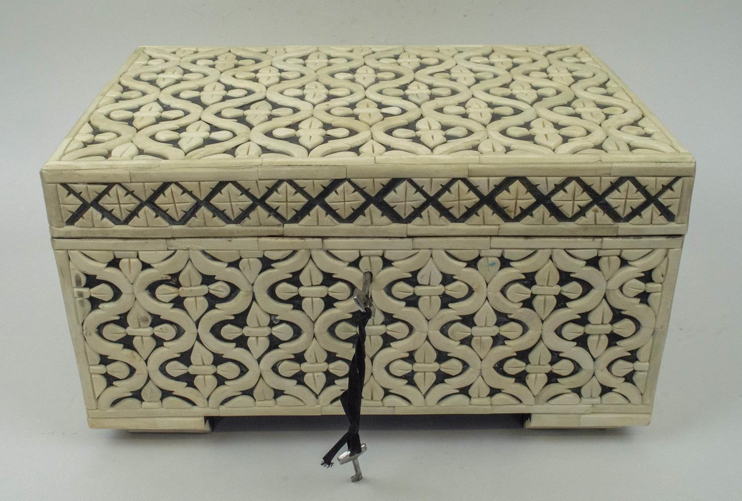 CASKET, bone geometric clad with hinged top and interior tray, 22cm H x 38cm x 25cm.