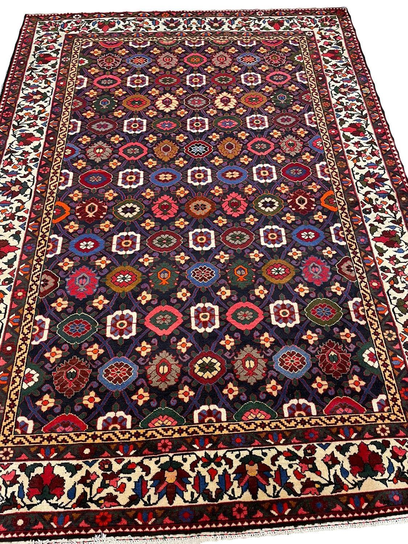 FINE PERSIAN BAKTIAR CARPET, 325cm x 225cm, stylised mina khani design.