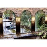 ARCHITECTURAL GARDEN WALL MIRRORS, a set of three, gilt metal arched top design, 107m x 55cm. (3)
