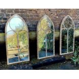 ARCHITECTURAL GARDEN WALL MIRRORS, a set of three, Gothic revival style, 122cm x 66cm. (3)